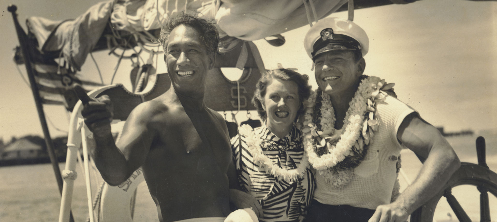 Duke on a boat with happy couple