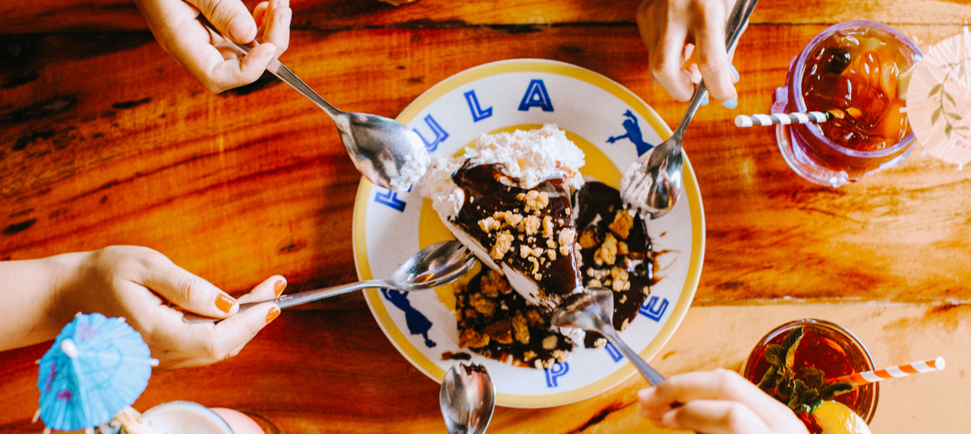 Top-down shot of a Hula Pie being eaten with sporks
