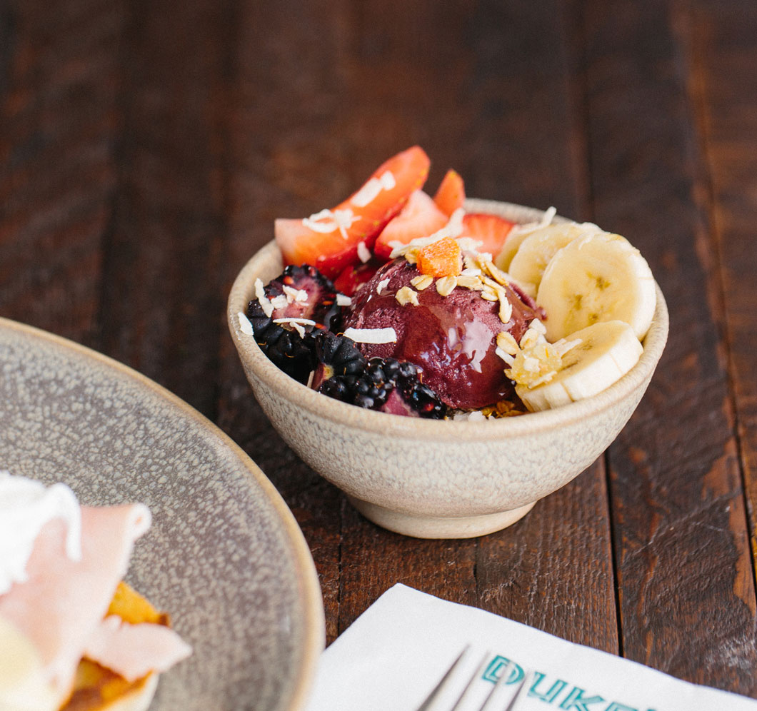 bowl of acai with bananas and assorted berries
